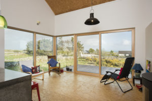 A large and open space with large fixed windows and sliding doors